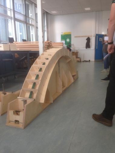 Arch beam bridge with tension strap