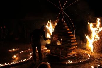 scot lighting the fire cone