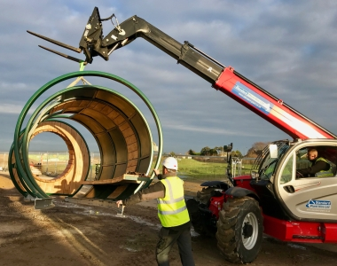 Berewood Hoop Youth Shelter during installion with telehandler